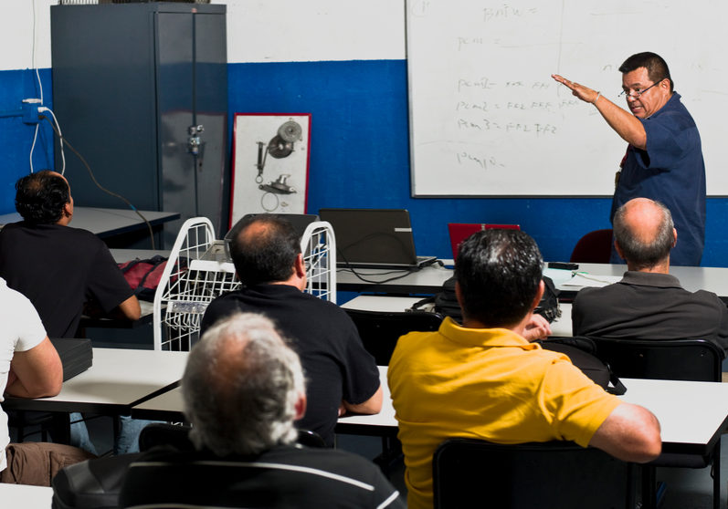 Hispanic Mechanics at a Training Class (this picture has been taken with a Hasselblad H3D II 31 megapixels camera)